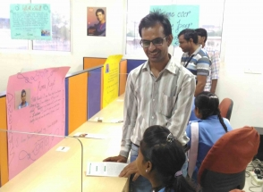 ISYS Softech company Employees interacting with rural students